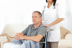 Man in his wheelchair Royalty Free Stock Photo
