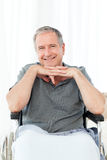 Man on his wheelchair looking at the camera Stock Photos