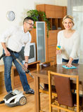 Man and his wife cleaning at home Stock Images