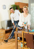 Man and his wife cleaning at home Stock Photography