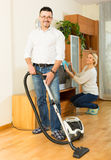 Man and his wife cleaning at home Stock Photos