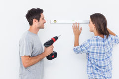 Man and his wife doing diy together Royalty Free Stock Image