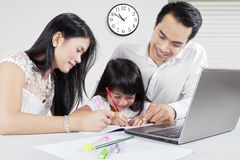 Man and his wife teach their daughter Royalty Free Stock Image