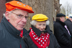 Man and his wife watch the carnival parade. Royalty Free Stock Photo