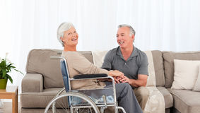 Man with his wife in a wheelchair Stock Photos