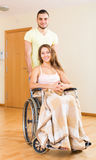 Man and his wife in wheelchair at the door Stock Photo