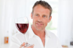 Man with his wineglass in his kitchen Stock Photo