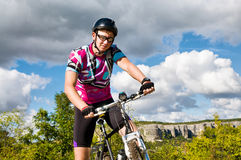 Man with hismuontain-bike Royalty Free Stock Image