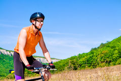 Man with hismuontain-bike Stock Image