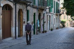 Man in the historic road of valldemossa of mallorca royalty free stock images