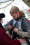 Man in historical costume (a knight) prepares for a battle. Royalty Free Stock Photo