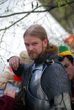 Man in historical costume (a knight) prepares for a battle. Royalty Free Stock Image