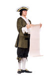 Man in a historical costume read the decree. Young man in a historical costume read the decree Royalty Free Stock Photography