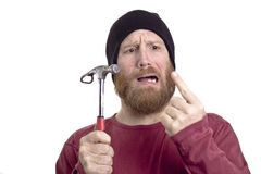 Man hit finger with hammer Royalty Free Stock Photo