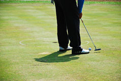 Man hit golf into hole green grass Royalty Free Stock Images