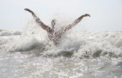 Man hit by waves Stock Image