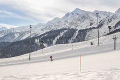The man hitched a lift. The complex mountain-ski runs and facilities in the village of Rosa Khutor Stock Images