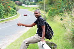 Man hitchhiking Stock Photography