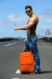 Man hitchhiking Stock Photography