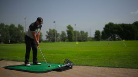 The man hits the ball a club stock footage