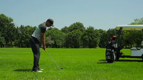 The man hits the ball in golf stock footage