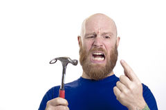 man hits finger with hammer Stock Images