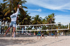 Man Hits Jump Serve In Miami Pickup Beach Volleyball Game Stock Images