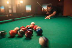 Man hits a pyramid in billiards. Royalty Free Stock Images
