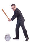 Man hitting the clock with baseball bat Stock Image