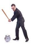 Man hitting the clock with baseball bat Stock Image