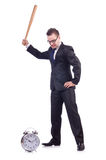 Man hitting the clock with baseball bat Stock Photo