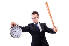 Man hitting the clock with baseball bat isolated Royalty Free Stock Photography