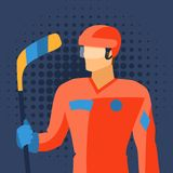 Man in hockey gear stands with stick Stock Image
