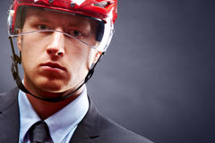 Man in hockey helmet. Portrait of young businessman with hockey helmet on head stock photos