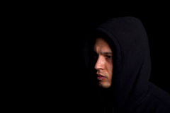 Man with hoddie. Stylish young man with hoddie over a black background Royalty Free Stock Photo