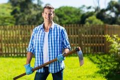 Man hoe garden Stock Images