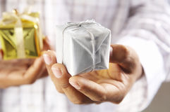 Man hoilding a gift box Stock Images