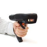 Man hold bar code scanner and scans  with laser Royalty Free Stock Photo