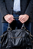 Man hold a black bag Stock Images