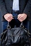 Man hold a black bag Stock Images