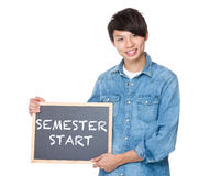 Man hold with blackboard showing phrase of semester start Royalty Free Stock Photo