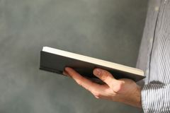 Man hold book in hands stock images