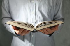 Man hold book in hands stock image