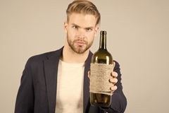 Man hold bottle of wine, alcohol. Macho with bottle, bad habits. Sommelier or degustator with wine, winery. Alcohol royalty free stock images