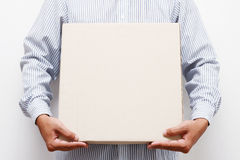 Man hold brown paper box. Man holding brown paper box Stock Photography