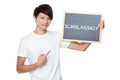 Man hold with chalkboard showing a word scholarship Stock Images