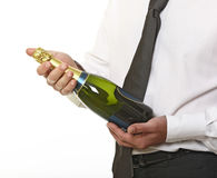 Man hold champagne bottle Stock Photos