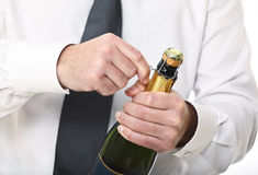 Man hold champagne bottle Stock Photography