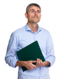 Man hold with clipboard and look away Stock Photos