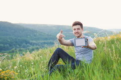 Man hold an eBook and points by finger on book Royalty Free Stock Image